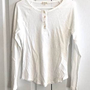 Waffle cotton material. Long sleeved slim fit top.